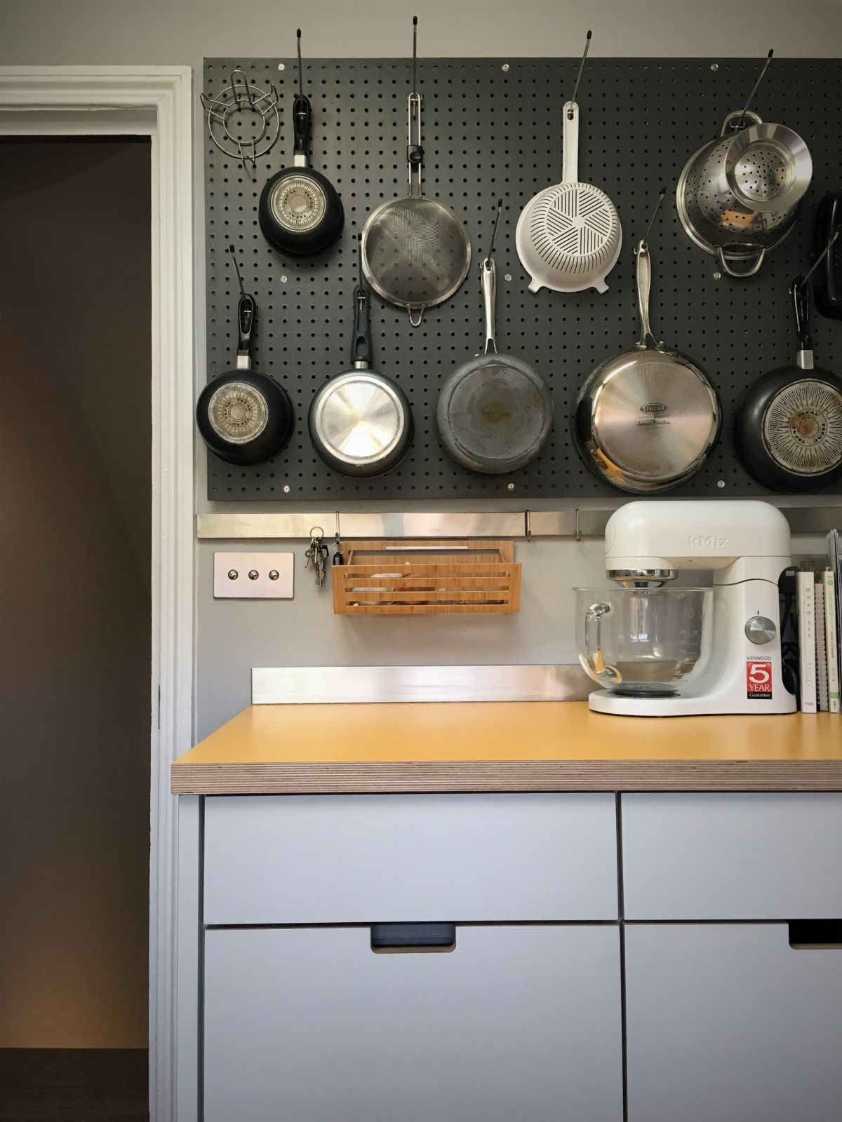 small kitchen grey pegboard provides efficient wall hanging