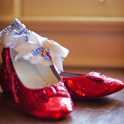 A sweet spring wedding with ruby slippers and other nods to The Wizard of Oz ~ captured by PhotoBella Photography.