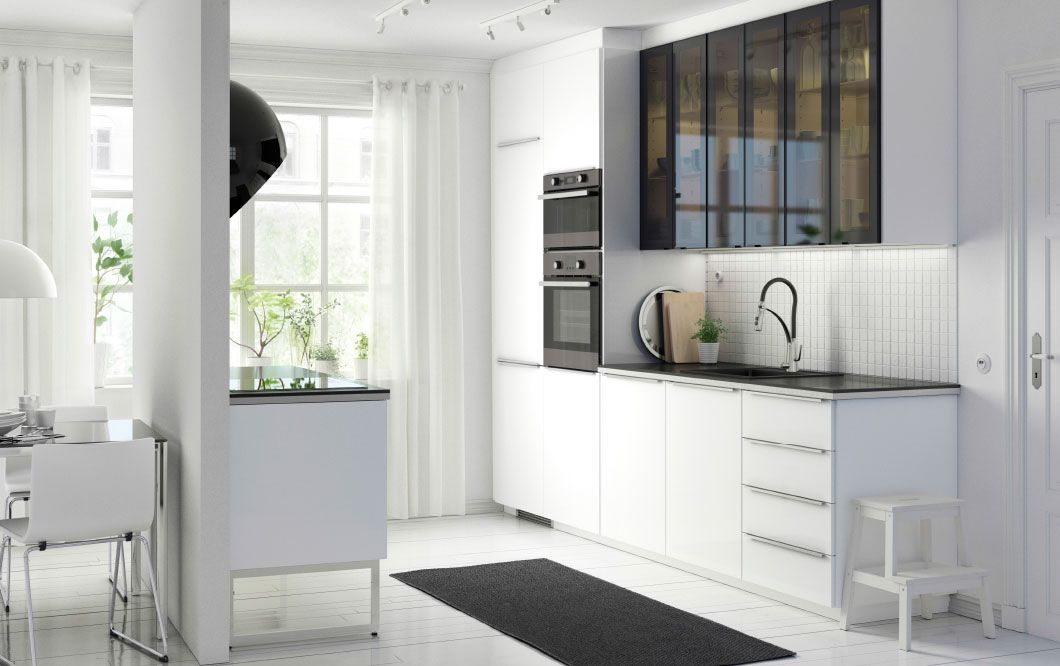 a modern white metod kitchen with ringhult high gloss white fronts h llestad black worktops and. Black Bedroom Furniture Sets. Home Design Ideas