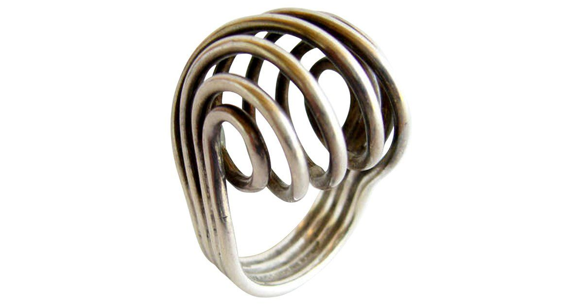 Rare, spiraled sterling silver ring designed by Anna Greta Eker for the Plus silversmithy of Norway. Size: 6.5. Signed: AGE, +, 925S, Sterling, Norway. In very good vintage condition.