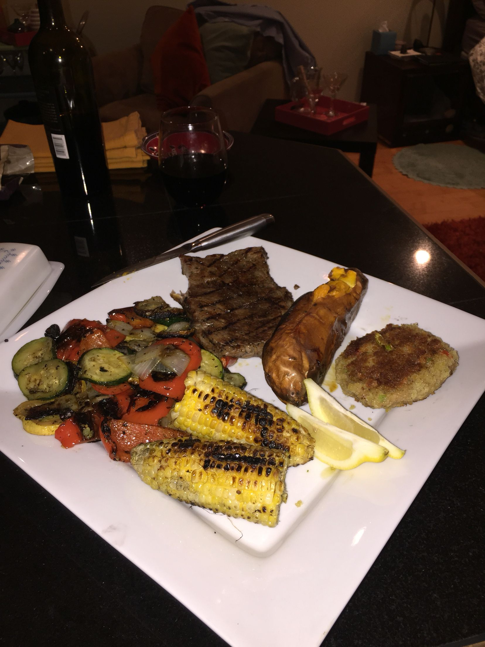 Steak, crab cake and grilled veggies. Very simple. One plate dinner date. Yum!