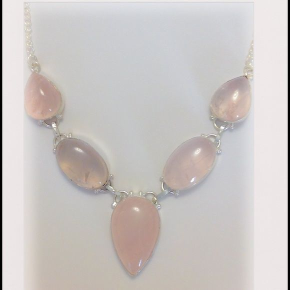 Gorgeous Genuine Rose Quartz Statement Necklace Pretty in pink!  This is such a pretty & feminine necklace!  Made from genuine natural Rose quartz & .925 Sterling silver.  Approx 17 inches long.  Please contact me w/any of your questions.  Thank you for visiting! Genuine Gemstones Jewelry Necklaces