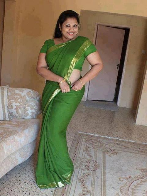 mature belly on Indian laying women