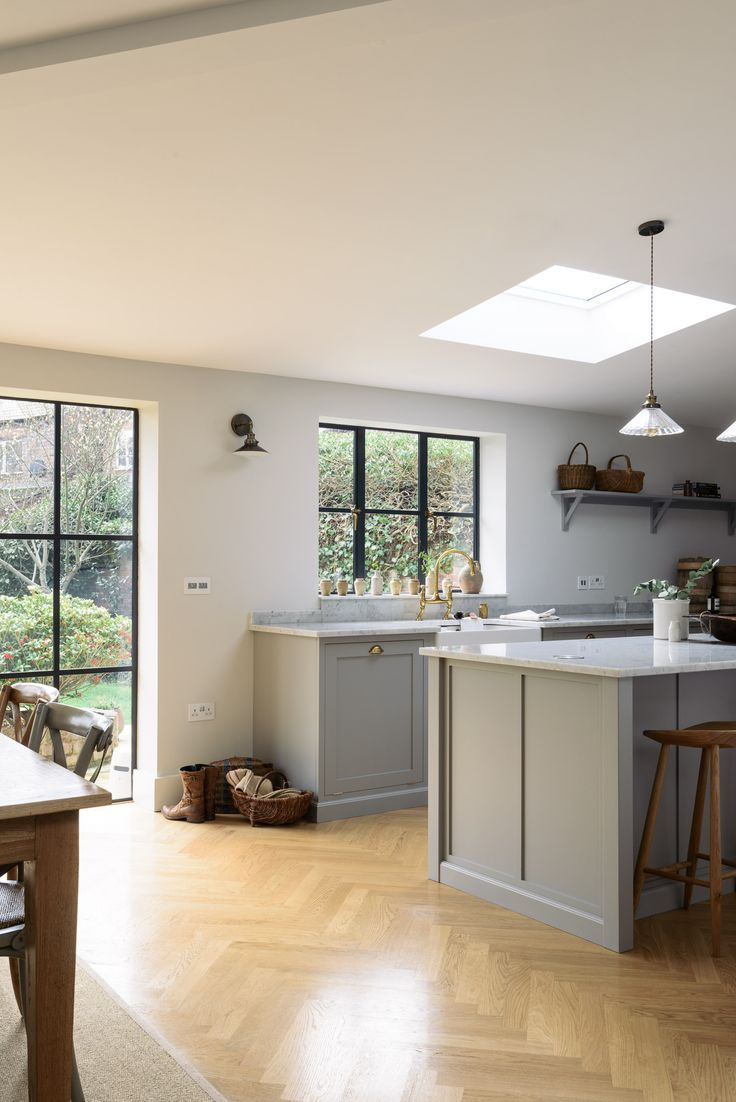 A Beautiful Wooden Parquet Floor Complements The Soft Grey Cupboards - Soft grey kitchen