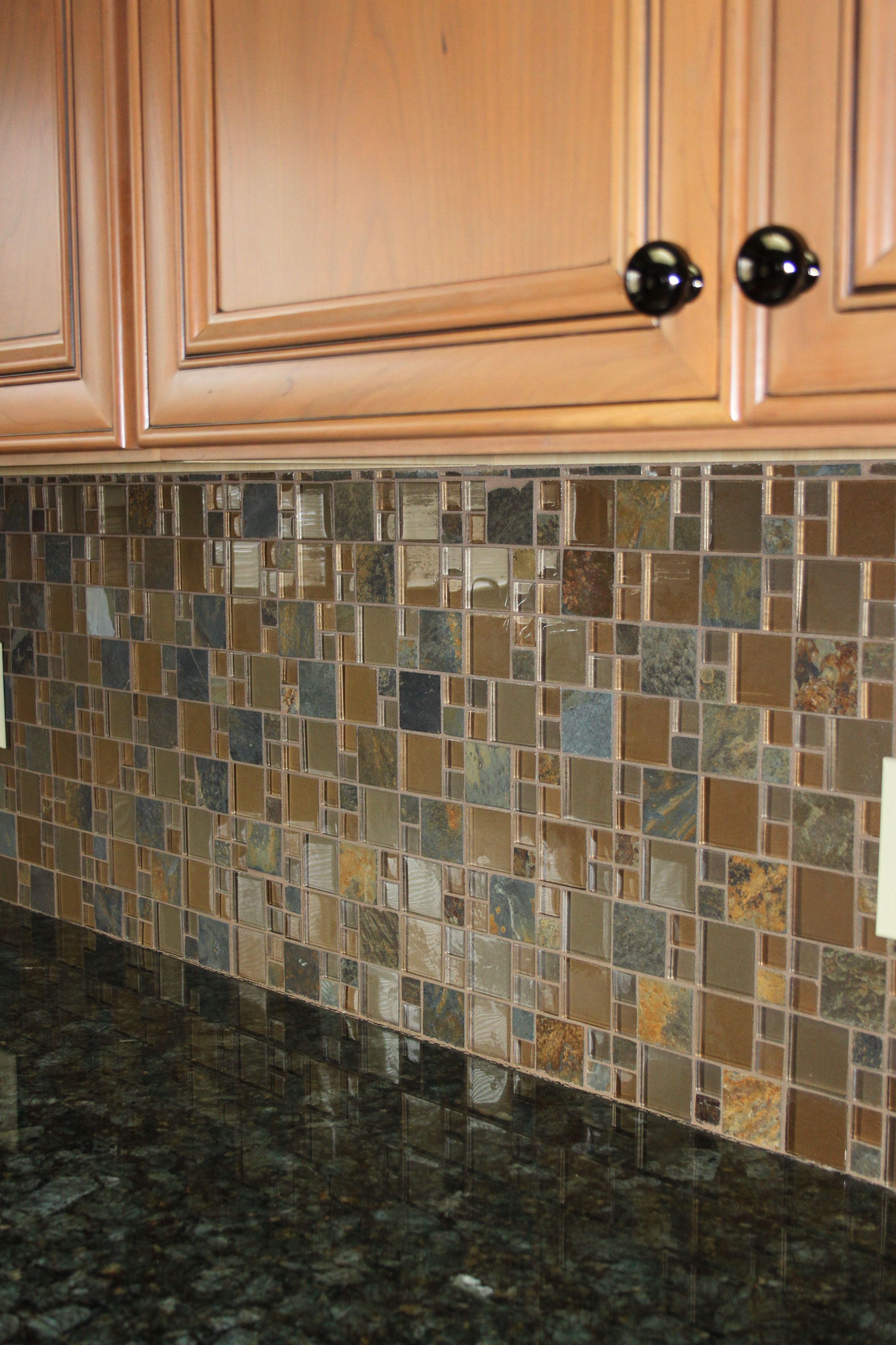 Verde Peacock Granite Top With A Glass Slate Mosaic