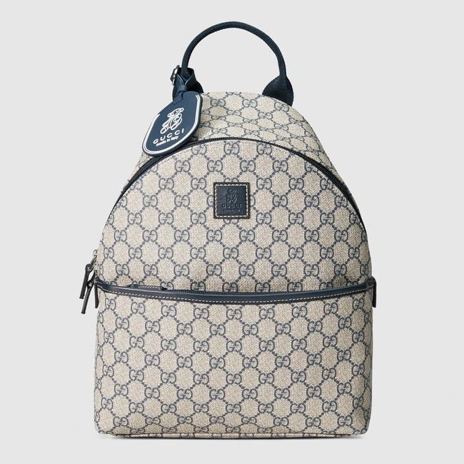 3e5e70dc9ac Gucci children s GG Supreme backpack with blue leather trim ...