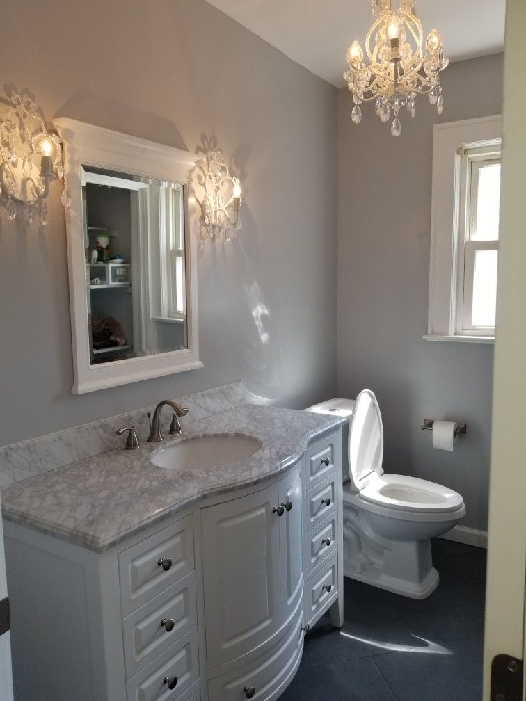 Our Bathroom Remodel Slate Floor Tiles With A White Vanity With - Top bathroom remodels