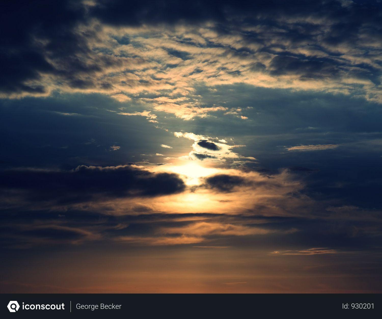 Free Sun Behind Dark Clouds Photo Cloud Photos Clouds Dark Clouds