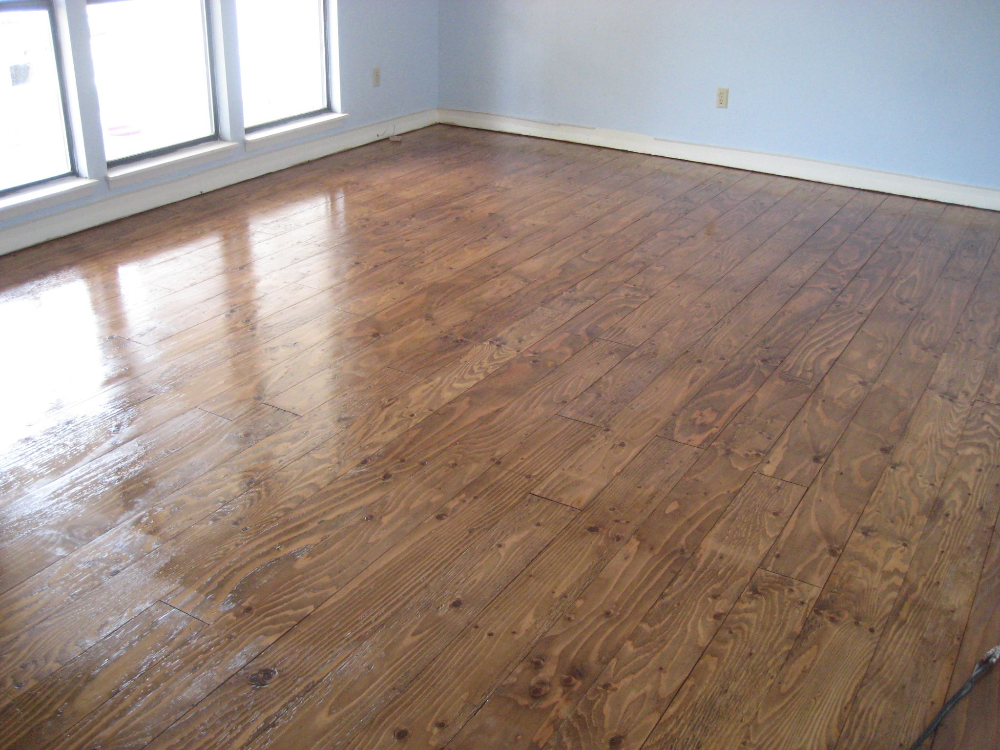We installed real wood floors made from plywood in our - Inexpensive flooring ideas for living room ...