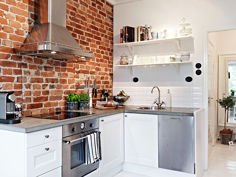 Pequeño estudio decorado en blanco con contrastes Kitchen brick