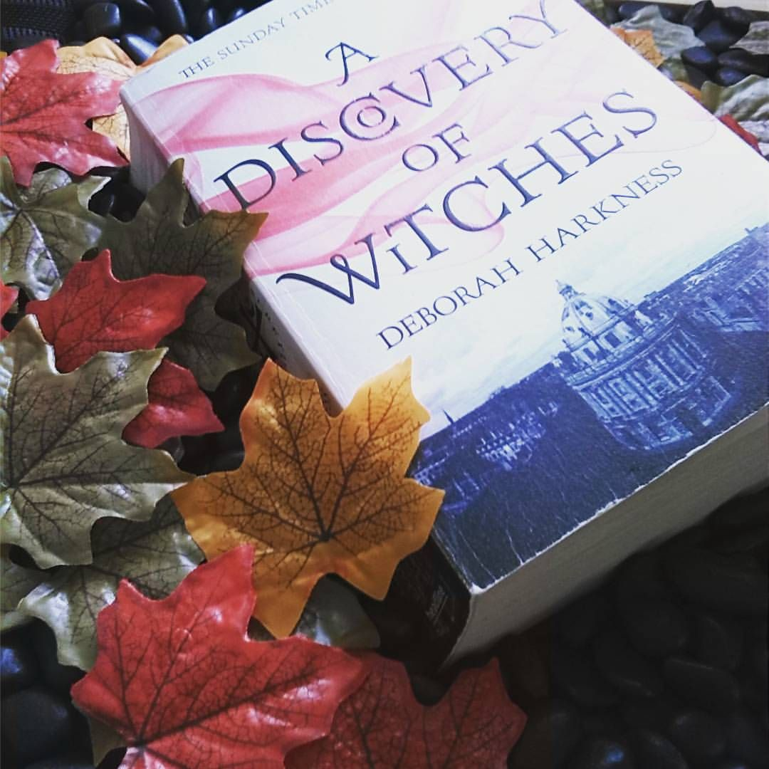 "What a perfect autumn picture from tundrablue on Instagram: ""Day 10 in the #octobercryptchallenge15 and I've just finished rereading #adiscoveryofwitches by debharkness and couldn't resist using it in today's Book + Leaves pic.  However, as it's spring in Australia I had to go with the fake autumn leaves (which are super hard to find in a country town!) ;-D"" We admire her creativity in the midst of her Australian spring!"