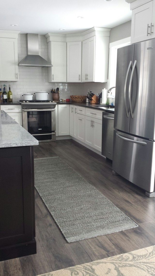 Laminate Flooring In A Kitchen engineered wood installed cost 4 to 9 per square foot Before And After Kitchen On Gardenweb Wall Is Bm Rockport Gray The Dark Cabinets And Gray Floor