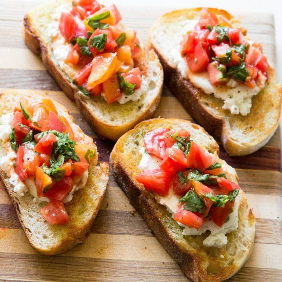This super easy buttery burrata cheese bruschetta has fresh heirloom tomatoes and basil on garlic infused bread.