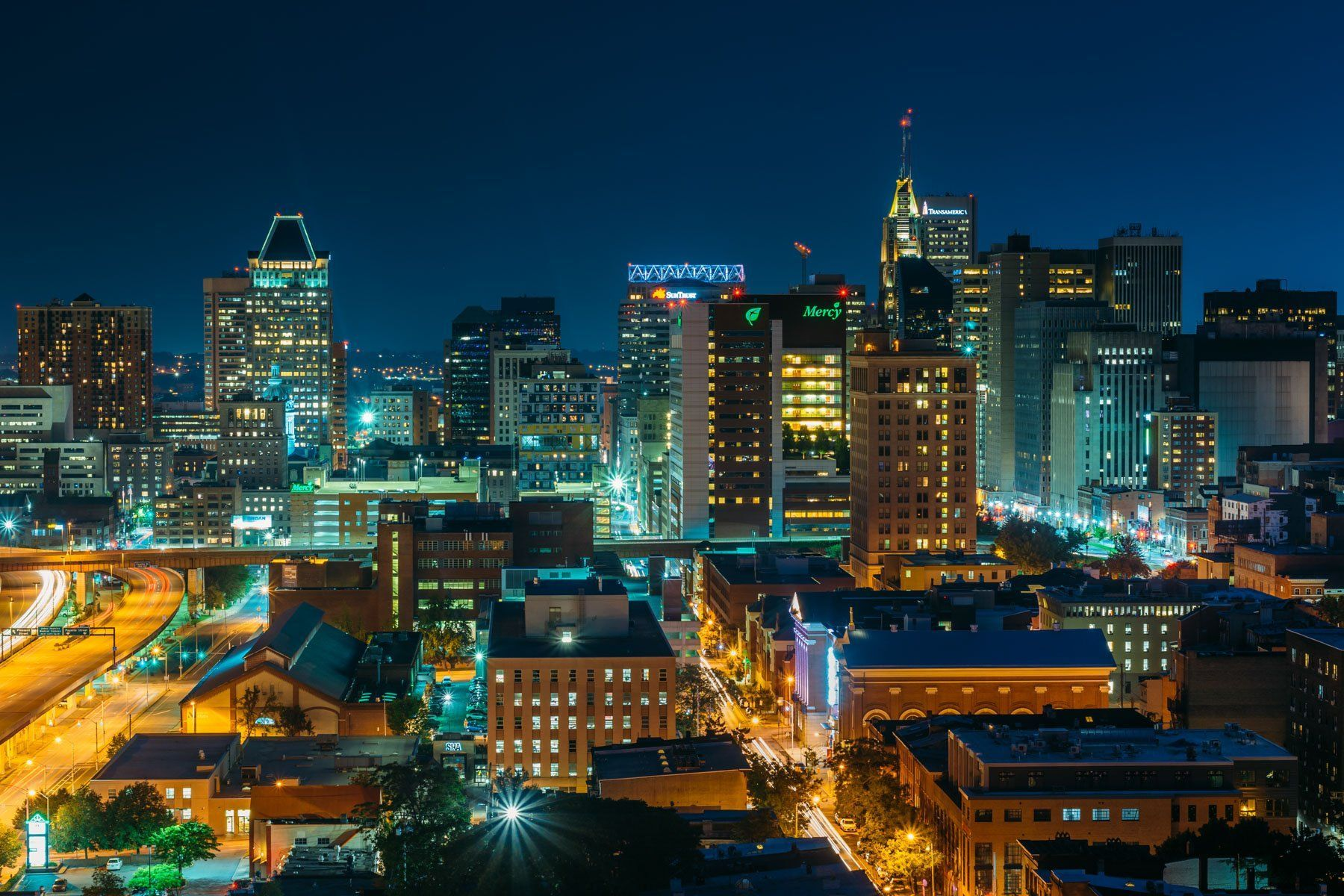 View Of The Downtown Baltimore Skyline At Night In Maryland