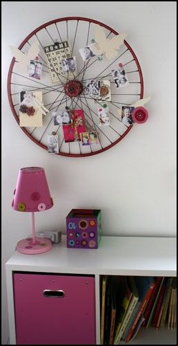 Old bike wheel turned memo board