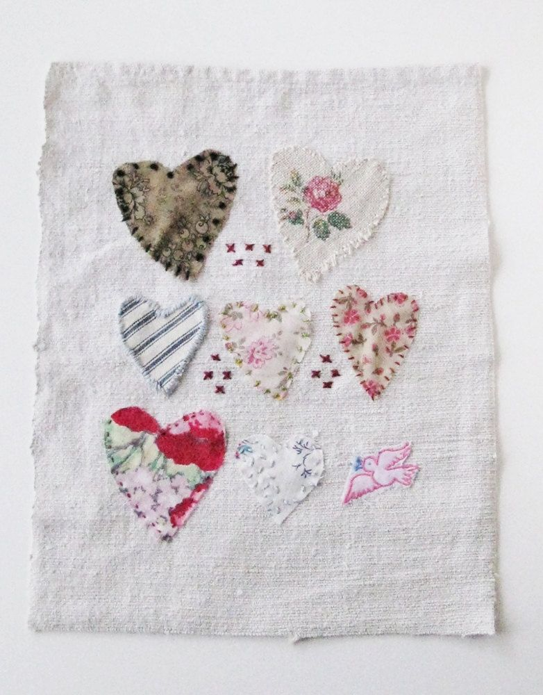 Small art quilt on antique linen, Hearts and kisses. $45.00, via Etsy.