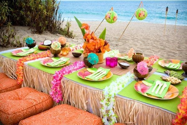 Fun beachy table decorations for a luau party - coconuts, grass skirts, leis  more #luau #beach #party