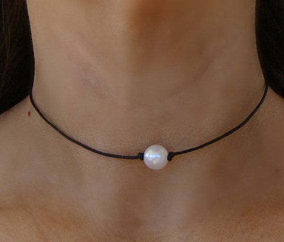This choker necklace is made of black leather cording and is adorned with an 10mm round white pearl focal bead. Necklace is finished with a pearl slip clasp clasp for a secure closure and easy wear. Choose from your choice of cord length: 11 to 20 ***PLEASE measure your neck before ordering to insure a good fit!! To measure neck, place string around neck where you would like necklace to fit then measure string with ruler. ****FAST US SHIPPING!! Shipping usually takes between 3 and 7 days…