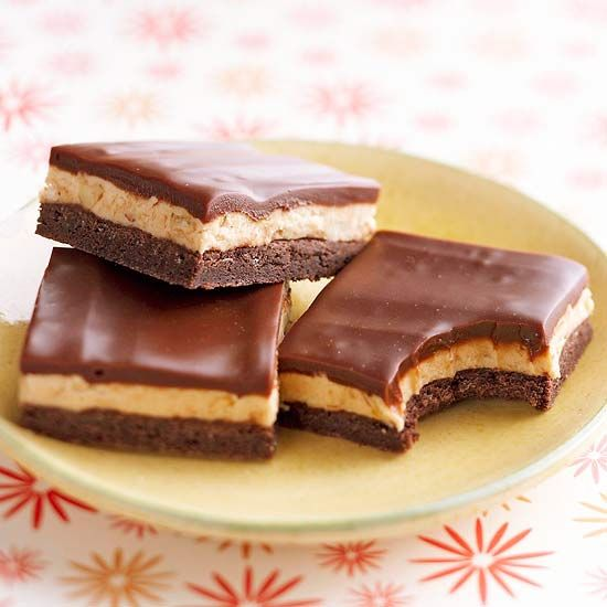 Honey-Roasted Peanut Butter Bars with Chocolate Ganache  With a rich layer of devil's food cake, a creamy peanut butter filling, and a fudgy topping, these easy bar cookies are a chocoholic's dream.