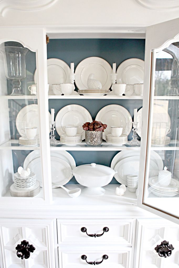 Styling a Dining Room Hutch is part of China Cabinet Organization - My other big project for February (besides my office bathroom renovation) was making over this Goodwill china cabinet  The last time we talked, I told ya how I started the vamping up process where I took the piece from veneered wood to painted white  Now it's a bright little sunshine in my morning (or a     Read More about Styling a Dining Room Hutch