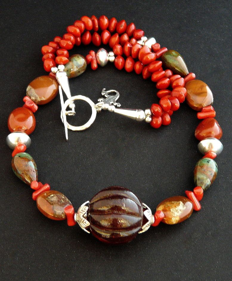 This vibrant Necklace showcases three different types of Jasper in warm earth tones, including Red Jasper, Bruneau Jasper (brownish-red with tan matrix) and Stone Jasper (green & red-orange). The oval