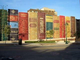 Kansas City Public Library, MO.   The south wall of the library's parking garage resembles a bookshelf: each book is around 25 feet tall and nine feet wide. It was constructed as an homage to 22 favorite literary titles, chosen by patrons of the library.