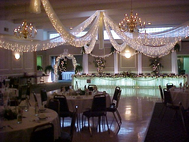 Decorating With White Fairly Lights Using Lighting To Decorate Your Wedding Wedding Wedding Reception Lighting Wedding Lights Wedding Reception Decorations