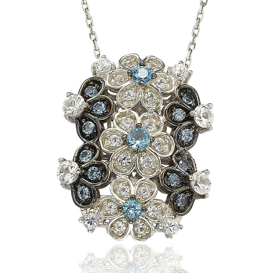 This dazzling pendant features blue and white cubic zirconia hand set in sterling silver with a unique designer Suzy Levian gallery and a Suzy Levian signature secret diamond inside the back gallery. Embrace the diamond in yourself.