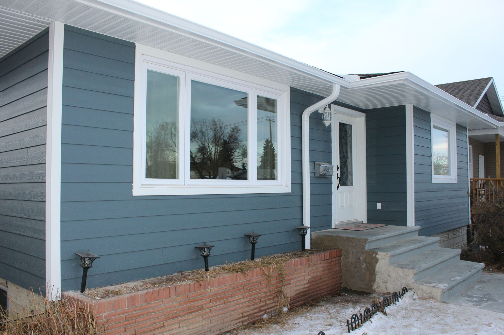 Evening Blue Hardie Board With White Trim Ranch House Exterior