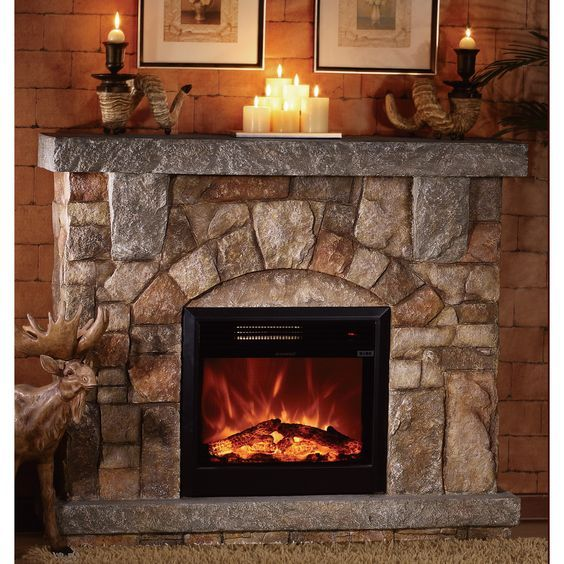 Unique Accessories Give Electric Fireplace Character This Electric Fireplace Ge Electric Fireplace With Mantel Stone Electric Fireplace Electric Fireplace