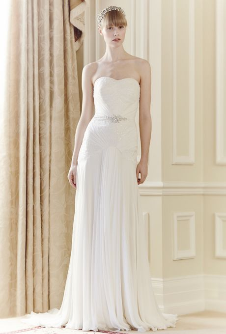 Jenny Packham. Floor length strapless gown, and A-line silhouette.