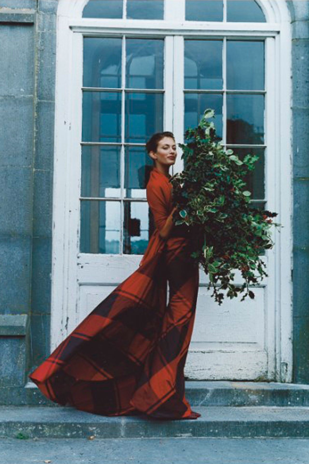 Holly leaves and a Hermès silk taffeta evening skirt for December 1997. Photo By Tim Walker/Vogue