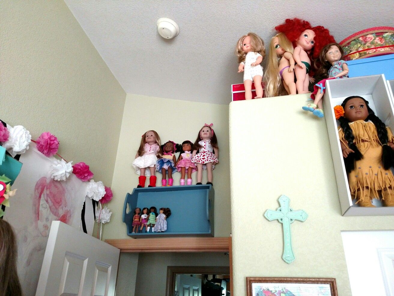 Above the door my niece entrusted some of her kirsten collection to