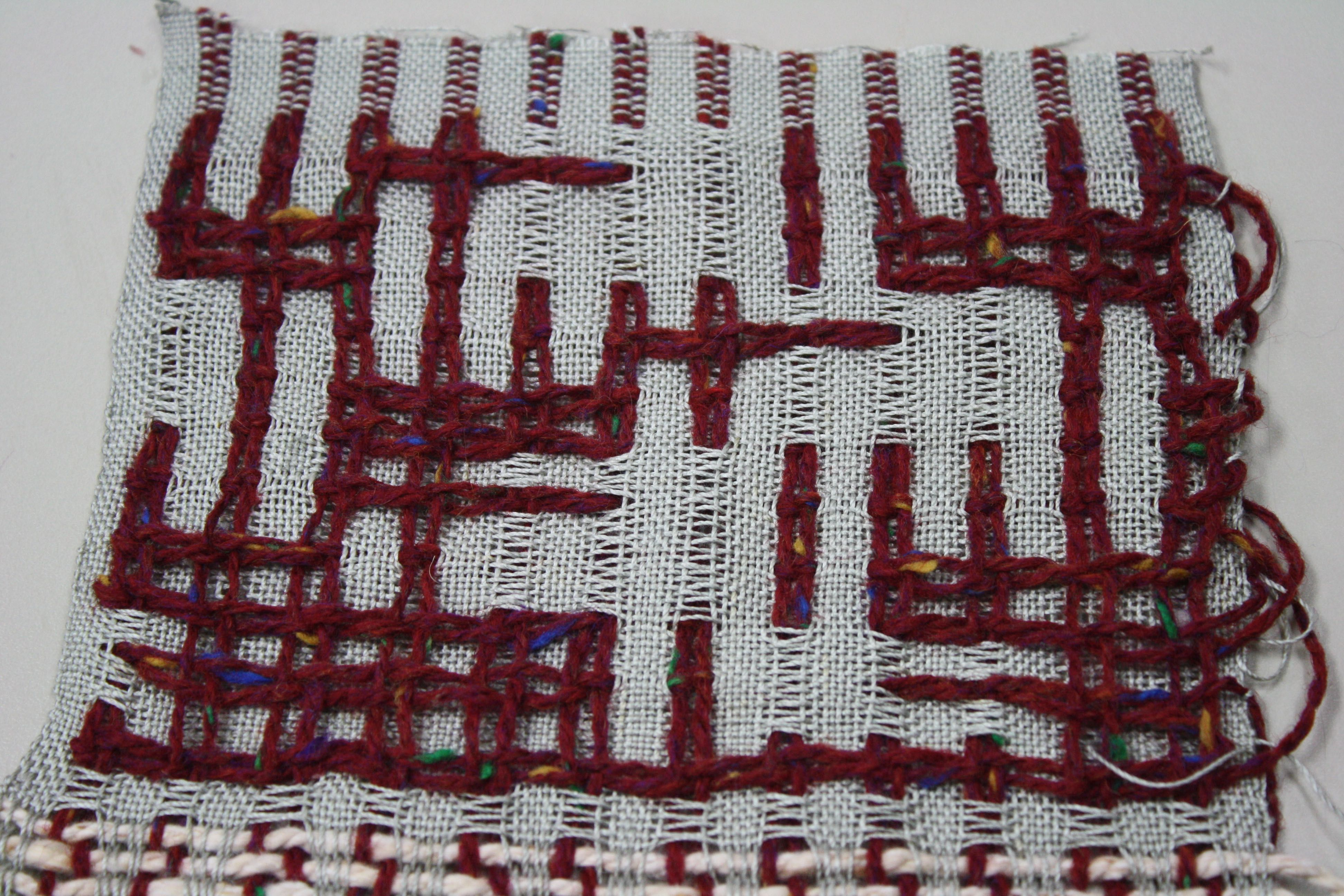 Deflected double weave sample before washing. 12 harness pattern. Warp and weft are 10/2 cotton and worsted weight wool.
