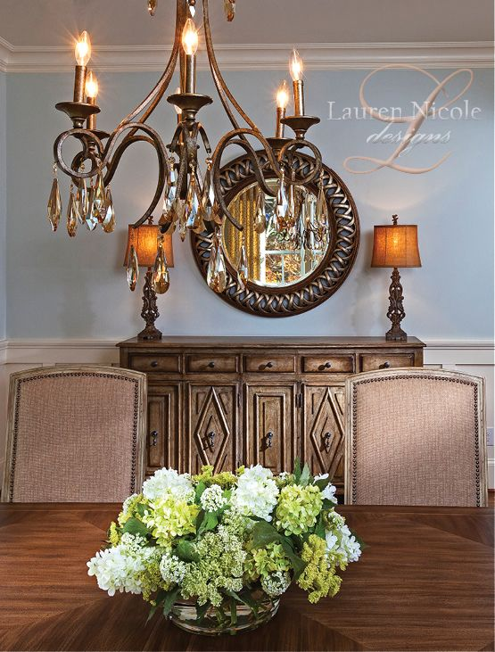 Stylish dining room chandelier and buffet. Lauren Nicole Designs | Dining Room Interior Design Charlotte NC Weddington