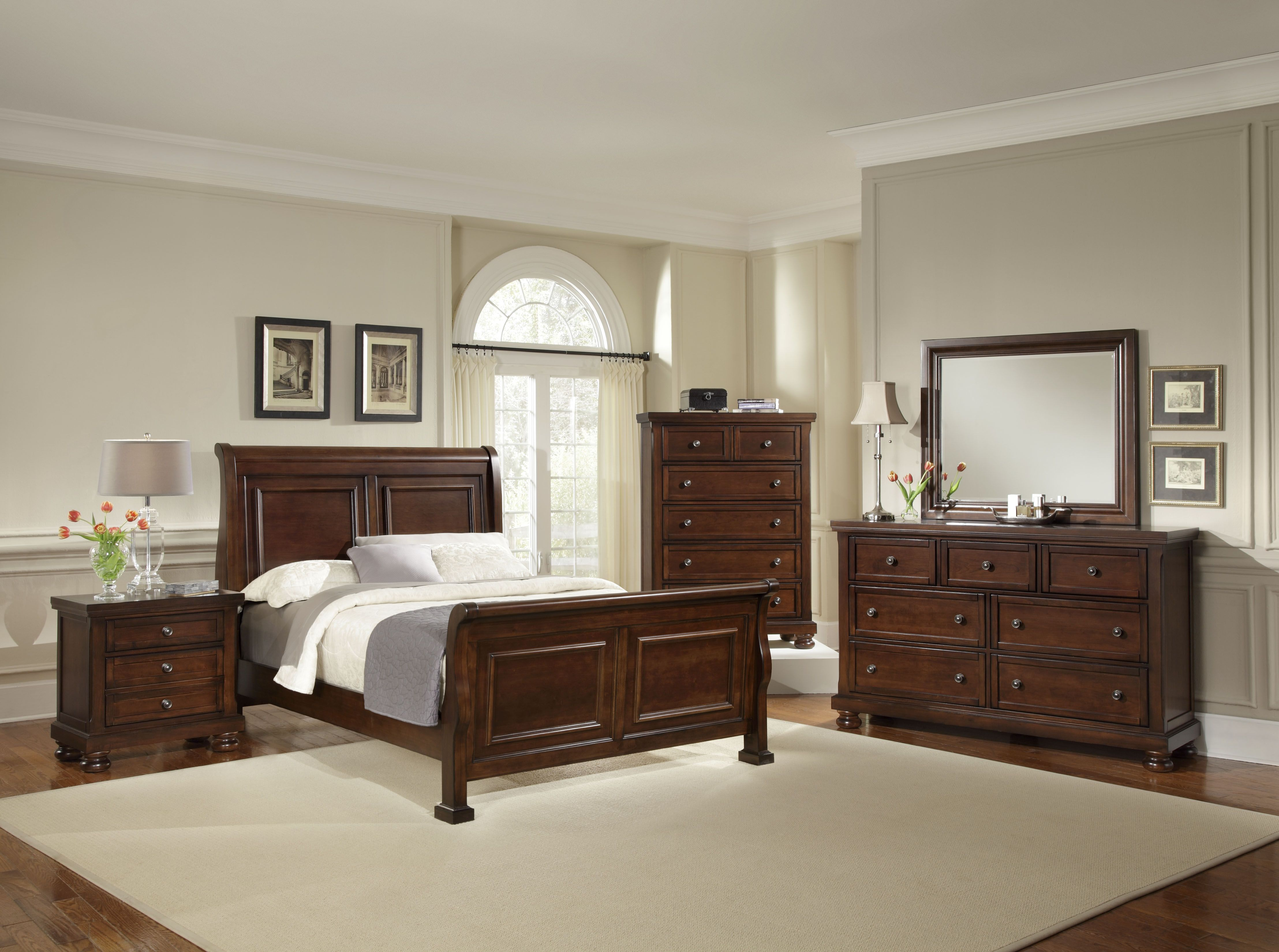 This beautiful bedroom features thoughtful detail and