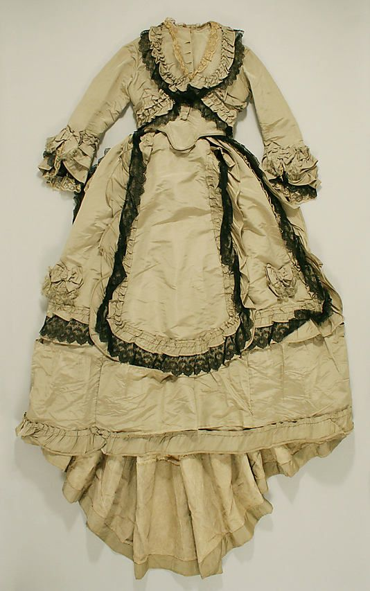 c1872 silk ensemble (with blue silk shoes). Trimmed with black silk lace. Met Museum.