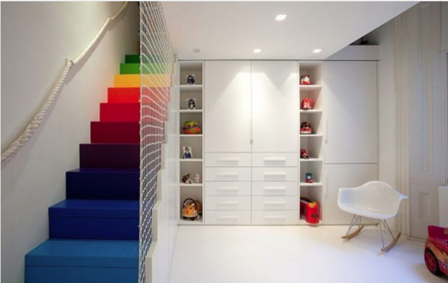 What a wonderful way to enter a playroom down rainbow coloured steps! Basement rooms don't need to be dismal when decorated in white and using lighting and accent colours to lift the scheme.