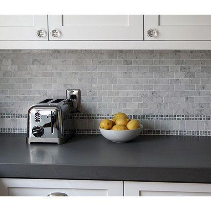 Stone Backsplash With Grey Countertop
