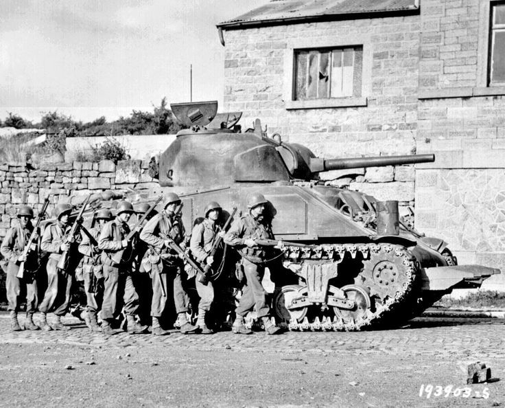 wwii american tanks on pinterest unpin | American troops of 60th Infantry Regiment advance into a Belgian town ...