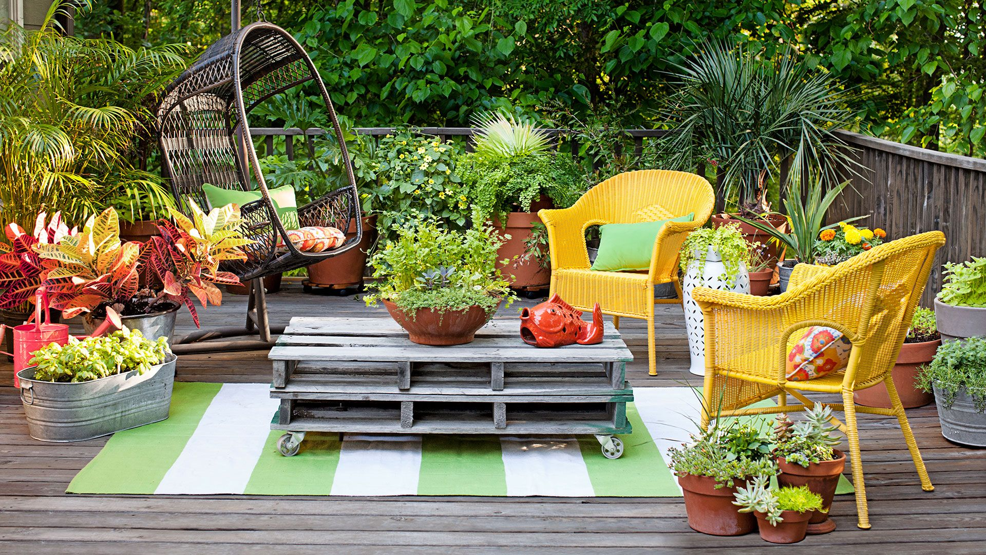 Cozy HangoutClark's biggest splurge, this all-weather swing chair, is crafted of sturdy faux rattan—and is the perfect size for gently swaying a parent and one snuggling kid. All Season(ings)No ornamental plants here: Clark's hardworking herbs—like this cilantro for her fave black-bean-and-corn salsa—get harvested 24/7.