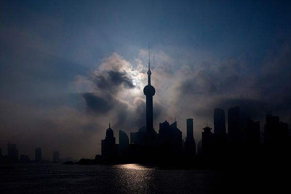 """An eclipse is seen at the Bund along the Huangpu River in Shanghai, China."""