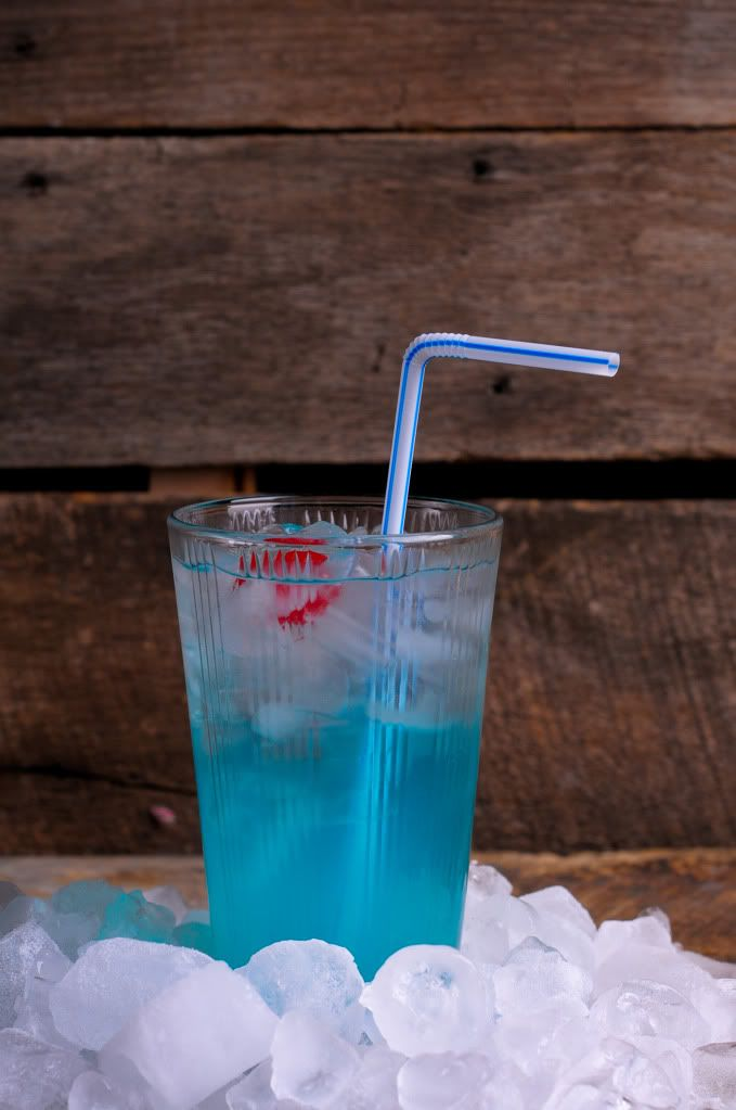 Blue Valium: 1 ounce vodka, 1/2 ounce blue curacao, Equal parts sweet 'n sour mix + Sprite, Garnish with a cherry