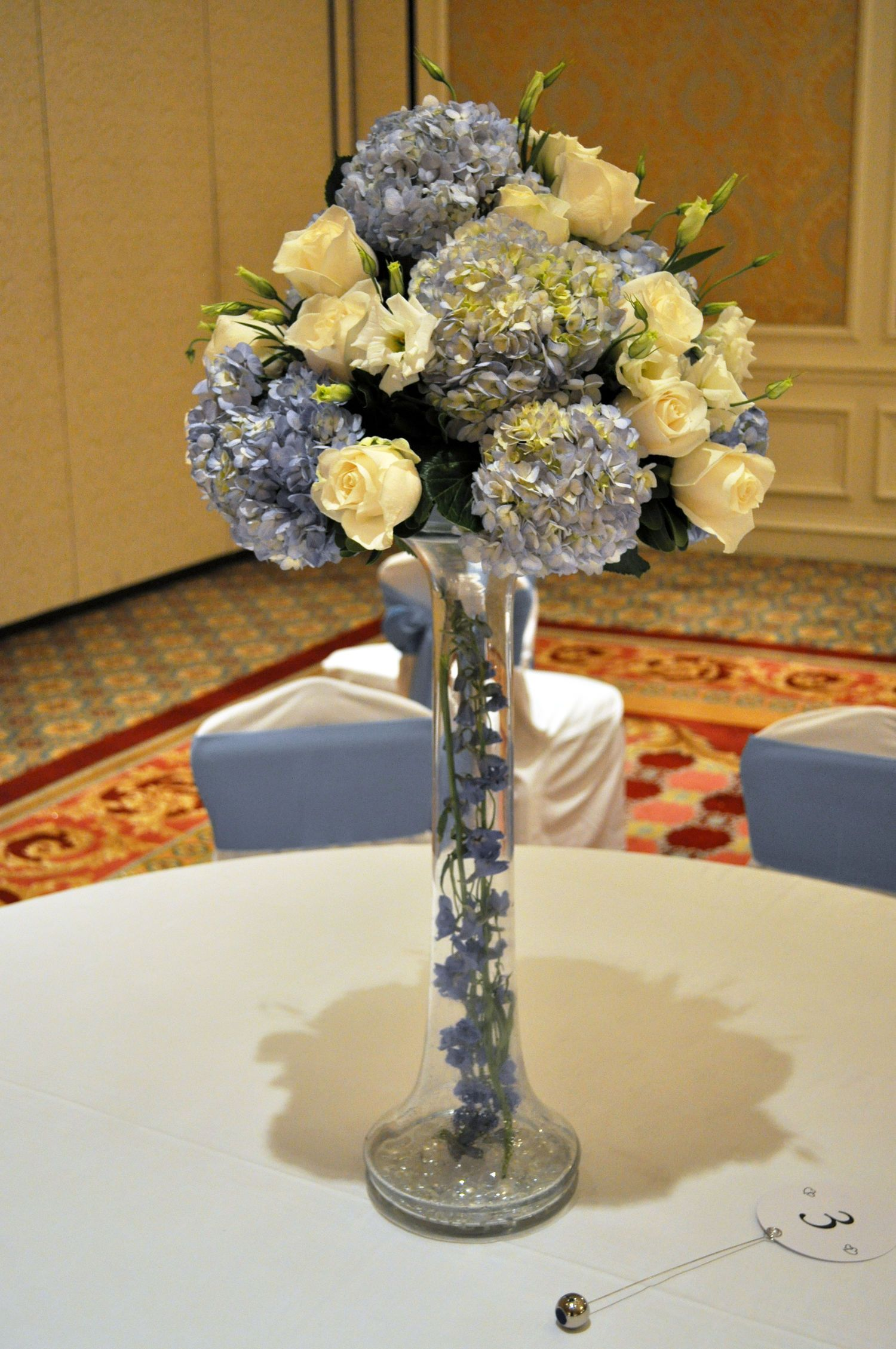 Tall blue and white tall vase with blue delphinium inside and a tall blue and white tall vase with blue delphinium inside and a top arrangement to reviewsmspy