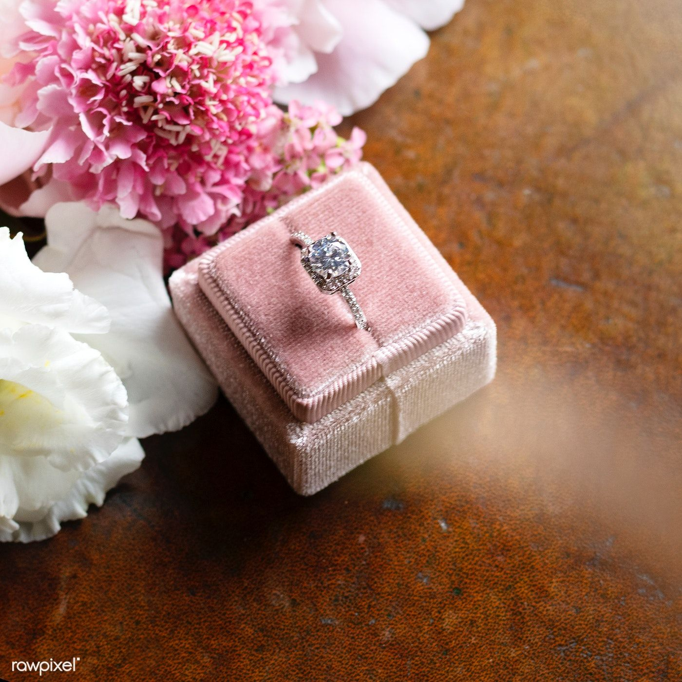 Download premium photo of Beautiful flowers by a diamond
