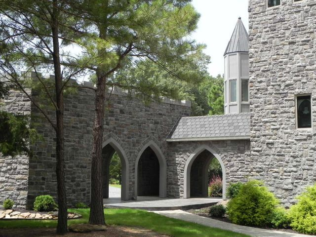 The cathedral/gothic arches, towers and turret at this gorgeous outdoor event venue create a beautiful backdrop for your pictures as you celebrate your special occasion! castlepinesfarm.com