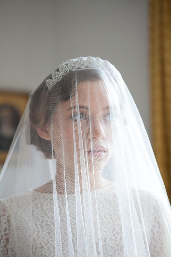 This Tiara Is So Beautiful! Plus I Really Love How She Is Wearing Her Veil OVER The Tiara, So When Her Husband Lifts Her Veil For THE KISS, The Veil Will Fall Behind Her Headpiece. So Romantic! ❤❤❤❤