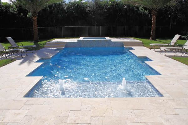 New swimming pool design includes sun deck with bubblers, custom ...