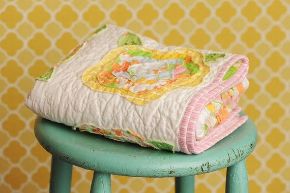 love these colors, pink binding, with yellow flowers with hints of orange and blue on white/off white muslin...