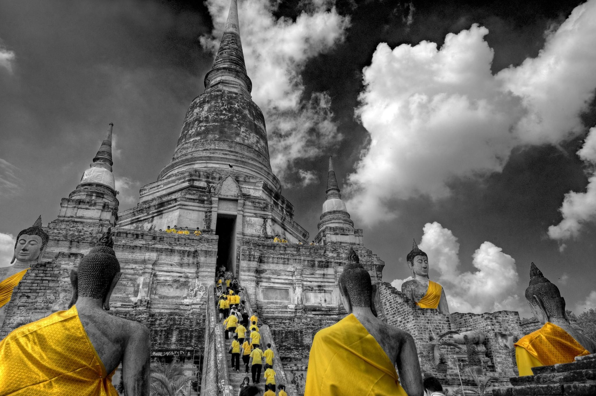 Home Of The Yellow Shirts - Schoolchildren ascending the stairs of Wat Yai Chai Mongkhon temple in Ayutthaya, Thailand.